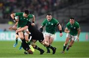 19 October 2019; Conor Murray of Ireland is tackled by Aaron Smith, left, and Sam Cane of New Zealand during the 2019 Rugby World Cup Quarter-Final match between New Zealand and Ireland at the Tokyo Stadium in Chofu, Japan. Photo by Ramsey Cardy/Sportsfile