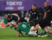 19 October 2019; Kieran Read of New Zealand is tackled by Jonathan Sexton and CJ Stander of Ireland during the 2019 Rugby World Cup Quarter-Final match between New Zealand and Ireland at the Tokyo Stadium in Chofu, Japan. Photo by Ramsey Cardy/Sportsfile