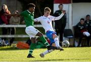 19 October 2019; Giddeon Tetteh of Republic of Ireland in action against Ingi Arngrimsson of Faroe Islands during the Under-15 UEFA Development Tournament match between Republic of Ireland and Faroe Islands at Westport in Mayo. Photo by Harry Murphy/Sportsfile