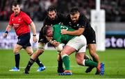 19 October 2019; Tadhg Furlong of Ireland is tackled by Samuel Whitelock and Angus Ta'avao of New Zealand during the 2019 Rugby World Cup Quarter-Final match between New Zealand and Ireland at the Tokyo Stadium in Chofu, Japan. Photo by Brendan Moran/Sportsfile