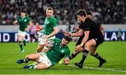 19 October 2019; Robbie Henshaw of Ireland in action against Beauden Barrett of New Zealand during the 2019 Rugby World Cup Quarter-Final match between New Zealand and Ireland at the Tokyo Stadium in Chofu, Japan. Photo by Brendan Moran/Sportsfile