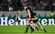 19 October 2019; Beauden Barrett of New Zealand is tackled by Garry Ringrose of Ireland during the 2019 Rugby World Cup Quarter-Final match between New Zealand and Ireland at the Tokyo Stadium in Chofu, Japan. Photo by Ramsey Cardy/Sportsfile