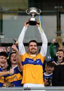 20 October 2019; Conor Clancy of St. Rynagh's lifts the trophy following the Offaly County Senior Club Hurling Championship Final match between Birr and St Rynaghs at O'Connor Park in Tullamore, Offaly. Photo by Harry Murphy/Sportsfile