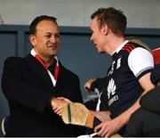 20 October 2019; An Taoiseach Leo Varadkar, T.D. , sporting a St Brigids scarf, congratulates the Cuala captain Colm Cronin before he collected the cup after the Dublin County Senior Club Hurling Campionship Final match between Cuala and St Brigids GAA at Parnell Park in Dublin. Photo by Ray McManus/Sportsfile
