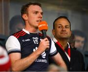 20 October 2019; An Taoiseach Leo Varadkar, T.D., sporting a St Brigids scarf, listens as the Cuala captain Colm Cronin makes a speech after the Dublin County Senior Club Hurling Campionship Final match between Cuala and St Brigids GAA at Parnell Park in Dublin. Photo by Ray McManus/Sportsfile