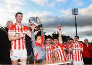 20 October 2019; Seamus Harnedy of Imokilly and Jamie Cashman, age 8, lifting the cup following the Cork County Senior Club Hurling Championship Final match between Glen Rovers and Imokilly at Pairc Ui Rinn in Cork. Photo by Eóin Noonan/Sportsfile