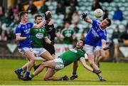 20 October 2019; Jeaic McKelvy and Leo McLoone of Naomh Conaill in action against Odhrán Mac Niallais of Gaoth Dobhair during the Donegal County Senior Club Football Championship Final match between Gaoth Dobhair and Naomh Conaill at Mac Cumhaill Park in Ballybofey, Donegal. Photo by Oliver McVeigh/Sportsfile