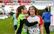 20 October 2019; Greta Hoey, left, and Kim Wilkinson-Daly embrace one another after finishing the SPAR Cross Country Xperience at the National Sports Campus Abbotstown in Dublin. Photo by Sam Barnes/Sportsfile