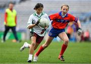 22 October 2019; Grace Galligan of St Patrick's GNS Hollypark Blackrock in action against Maggie O'Dea of Belgrove Senior GNS Clontarf in the match between Belgrove Senior GNS Clontarf and St Patrick's GNS Hollypark Blackrock during day one of the Allianz Cumann na mBunscol finals at Croke Park in Dublin. Photo by Matt Browne/Sportsfile