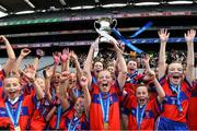 22 October 2019; Belgrove Senior GNS Clontarf captain Orla Hanratty lifts the cup as her team-mates celebrate after the match between Belgrove Senior GNS Clontarf and St Patrick's GNS Hollypark Blackrock during day one of the Allianz Cumann na mBunscol finals at Croke Park in Dublin. Photo by Matt Browne/Sportsfile