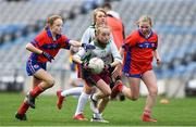 22 October 2019; Roisin Bourke of St Patrick's GNS Hollypark Blackrock in action against Eileen McCarthy and Orla Hanratty of Belgrove Senior GNS Clontarf in the match between Belgrove Senior GNS Clontarf and St Patrick's GNS Hollypark Blackrock during day one of the Allianz Cumann na mBunscol finals at Croke Park in Dublin. Photo by Matt Browne/Sportsfile