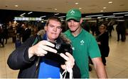 22 October 2019; Ireland supporter Stephen Cashel from Balbriggan, Co Dublin, takes a selfie with Jonathan Sexton on the Ireland Rugby Team's return at Dublin Airport from the Rugby World Cup. Photo by David Fitzgerald/Sportsfile