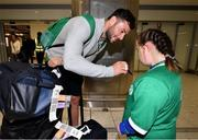 22 October 2019; Robbie Henshaw with supporter Jennifer Malone on the Ireland Rugby Team's return at Dublin Airport from the Rugby World Cup. Photo by David Fitzgerald/Sportsfile