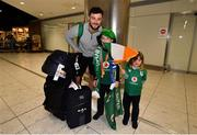 22 October 2019; Robbie Henshaw is greeted by supporters Luke, age 9, and Lauren Thomas, age 4, from Newry on the Ireland Rugby Team's return at Dublin Airport from the Rugby World Cup. Photo by David Fitzgerald/Sportsfile