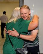 22 October 2019; Head coach Joe Schmidt receives a hug from supporter Mary Carroll from Ballsbridge, Co. Dublin on the Ireland Rugby Team's return at Dublin Airport from the Rugby World Cup. Photo by David Fitzgerald/Sportsfile