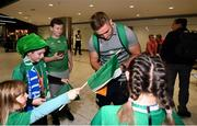 22 October 2019; Jordan Larmour is greeted by supporters on the Ireland Rugby Team's return at Dublin Airport from the Rugby World Cup. Photo by David Fitzgerald/Sportsfile