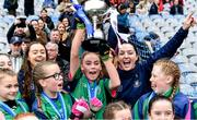 23 October 2019; Dublin ladies footballers Kate Fitzgibbon, left, and Sinéad Goldrick with the St Kevin's GNS, Kilnamanagh, players as they celebrate after beating Gaelscoil Eiscir Riara, Leamhcán, in the Corn na Laoch Cup Final during day two of the Allianz Cumann na mBunscol Finals at Croke Park in Dublin. Photo by Piaras Ó Mídheach/Sportsfile