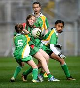 23 October 2019; Sorcha Hayes of St Raphaela's PS, Stillorgan, in action against against Our Lady Queen of the Apostles NS, Clonburris, players, from left, Isabelle Johns, Ashley Trusler, and Sophie Tapiz, in the Corn na Chladaigh Shield Final during day two of the Allianz Cumann na mBunscol Finals at Croke Park in Dublin. Photo by Piaras Ó Mídheach/Sportsfile