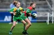 23 October 2019; Holly Garry of St Raphaela's PS, Stillorgan, in action against Madison Farrell O'Neill of Our Lady Queen of the Apostles NS, Clonburris, in the Corn na Chladaigh Shield Final during day two of the Allianz Cumann na mBunscol Finals at Croke Park in Dublin. Photo by Piaras Ó Mídheach/Sportsfile