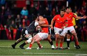 25 October 2019; Rory Scannell of Munster is tackled by Gareth Evans, left, and Tom Botha of Ospreys, hidden, during the Guinness PRO14 Round 4 match between Munster and Ospreys at Irish Independent Park in Cork. Photo by Sam Barnes/Sportsfile