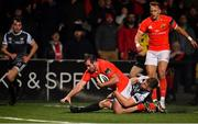 25 October 2019; James Cronin of Munster goes over to score his side's first try despite the tackle by Olly Cracknell of Ospreys during the Guinness PRO14 Round 4 match between Munster and Ospreys at Irish Independent Park in Cork. Photo by Sam Barnes/Sportsfile