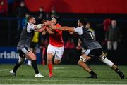 25 October 2019; Tyler Bleyendaal of Munster is tackled by Gareth Evans, right, and Tom Botha of Ospreys during the Guinness PRO14 Round 4 match between Munster and Ospreys at Irish Independent Park in Cork. Photo by Sam Barnes/Sportsfile