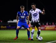 25 October 2019; Robbie Benson of Dundalk in action against Chris Forrester of St Patrick's Athletic during the SSE Airtricity League Premier Division match between Dundalk and St Patrick's Athletic at Oriel Park in Dundalk, Co Louth. Photo by Seb Daly/Sportsfile