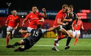 25 October 2019; Mike Haley of Munster slips the tackle from Cai Evans of Ospreys on his way to scoring his side's third try during the Guinness PRO14 Round 4 match between Munster and Ospreys at Irish Independent Park in Cork. Photo by David Fitzgerald/Sportsfile