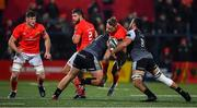 25 October 2019; Mike Haley of Munster is tackled by Gareth Evans, right, and Rhodri Jones of Ospreys during the Guinness PRO14 Round 4 match between Munster and Ospreys at Irish Independent Park in Cork. Photo by David Fitzgerald/Sportsfile