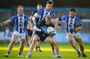 26 October 2019; Diarmuid McLoughlin of St Judes in action against Ballyboden St Endas players, from left, Darren O'Reilly, Rob McDaid and Bob Dwan during the Dublin County Senior Club Football Championship semi-final match between  Ballyboden St Endas and St Judes at Parnell Park, Dublin. Photo by David Fitzgerald/Sportsfile
