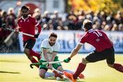 26 October 2019; Chris Cargo of Ireland scores his side's first goal despite the efforts of Gordon Johnston, 16, and Sukhi Panesar of Canada during the FIH Men's Olympic Qualifier match between Canada and Ireland at Rutledge Field, in West Vancouver, British Columbia, Canada. Photo by Darryl Dyck/Sportsfile