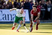 26 October 2019; Eugene Magee of Ireland and Adam Froese of Canada fight for the ball during the FIH Men's Olympic Qualifier match at Rutledge Field, in West Vancouver, British Columbia, Canada. Photo by Darryl Dyck/Sportsfile