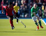 27 October 2019; Eugene Magee of Ireland, right, is pursued by Sukhi Panesar of Canada during the first half of the FIH Men's Olympic Qualifier match at Rutledge Field, in West Vancouver, British Columbia, Canada. Photo by Darryl Dyck/Sportsfile