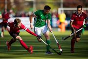 27 October 2019;  Shane O'Donoghue of Ireland is pursued by James Kirkpatrick of Canada, left, as Matthew Sarmento, right, watches during the second half of the FIH Men's Olympic Qualifier match at Rutledge Field, in West Vancouver, British Columbia, Canada. Photo by Darryl Dyck/Sportsfile