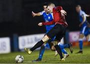 1 November 2019; Mark Doyle of Drogheda United has a shot on goal despite the tackle of Jacob Borg of Finn Harps during the SSE Airtricity League Promotion / Relegation Play-off Final 2nd Leg between Finn Harps and Drogheda United at Finn Park in Ballybofey, Donegal. Photo by Oliver McVeigh/Sportsfile