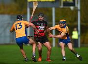 3 November 2019; Barry O'Sullivan of Ballygunner in action against Cathal Malone, left, and Seadna Morey of Sixmilebridge during the AIB Munster GAA Hurling Senior Club Championship Quarter-Final match between Sixmilebridge and Ballygunner at Sixmilebridge in Clare. Photo by Diarmuid Greene/Sportsfile