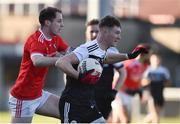 3 November 2019; Ryan McAvoy of Kilcoo in action against Jared Monaghan of O'Donovan Rossa during the AIB Ulster GAA Football Senior Club Championship quarter-final match between Kilcoo and O'Donovan Rossa at Páirc Esler in Newry, Down. Photo by Oliver McVeigh/Sportsfile
