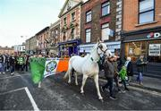 3 November 2019; Shamrock Rovers supporters lead Maggie the Horse through Ringsend along the traditional route to Aviva Stadium before the extra.ie FAI Cup Final between Dundalk and Shamrock Rovers at the Aviva Stadium in Dublin. Photo by Seb Daly/Sportsfile