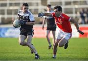 3 November 2019; Darryl Branagan of Kilcoo in action against Darren O'Neill of O'Donovan Rossa during the AIB Ulster GAA Football Senior Club Championship quarter-final match between Kilcoo and O'Donovan Rossa at Páirc Esler in Newry, Down. Photo by Oliver McVeigh/Sportsfile