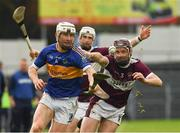 3 November 2019; Paul Flynn of Kiladangan in action against Paddy Stapleton of Borris-Ileigh during the Tipperary County Senior Club Hurling Championship Final match between  Borris-Ileigh and Kiladangan at Semple Stadium in Thurles, Tipperary. Photo by Ray McManus/Sportsfile