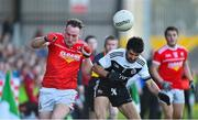 3 November 2019; Shane Heavron of O'Donovan Rossa in action against Niall Branagan of  Kilcoo during the AIB Ulster GAA Football Senior Club Championship quarter-final match between Kilcoo and O'Donovan Rossa at Páirc Esler in Newry, Down. Photo by Oliver McVeigh/Sportsfile
