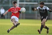 3 November 2019; Simon McErlain of O'Donovan Rossa in action against Niall Branagan of  Kilcoo during the AIB Ulster GAA Football Senior Club Championship quarter-final match between Kilcoo and O'Donovan Rossa at Páirc Esler in Newry, Down. Photo by Oliver McVeigh/Sportsfile