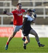 3 November 2019; Darryl Branagan of Kilcoo in action against Conor Kearns of O'Donovan Rossa during the AIB Ulster GAA Football Senior Club Championship quarter-final match between Kilcoo and O'Donovan Rossa at Páirc Esler in Newry, Down. Photo by Oliver McVeigh/Sportsfile