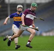 3 November 2019; James 'JD' Devaney of Borris-Ileigh on his way to scoring a point under pressure from  David Sweeney of Kiladangan during the Tipperary County Senior Club Hurling Championship Final match between  Borris-Ileigh and Kiladangan at Semple Stadium in Thurles, Tipperary. Photo by Ray McManus/Sportsfile