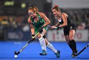 3 November 2019; Zoe Wilson of Ireland in action against Rachel Donohoe of Canada during the FIH Women's Olympic Qualifier match between Ireland and Canada at Energia Park in Dublin.  Photo by Brendan Moran/Sportsfile