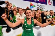 3 November 2019; Roisin Upton of Ireland celebrates with friends and family after qualifying for the Tokyo2020 Olympic Games after the FIH Women's Olympic Qualifier match between Ireland and Canada at Energia Park in Dublin. Photo by Brendan Moran/Sportsfile