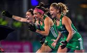 3 November 2019; Ireland players, from left, Roisin Upton, Bethany Barr and Chloe Watkins celebrate winning the penalty strokes and qualifying for the Tokyo2020 Olympic Games during the FIH Women's Olympic Qualifier match between Ireland and Canada at Energia Park in Dublin. Photo by Brendan Moran/Sportsfile