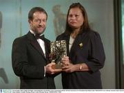 28 November 2003; Emilie O'hAilpin, representing her son Setanta, Cork, is presented with his All-Star award by GAA President Sean Kelly at the VODAFONE GAA All-Star Awards in the Citywest Hotel, Dublin. Football. Hurling. Picture credit; Brendan Moran / SPORTSFILE *EDI*