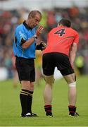 23 June 2013; Referee Eddie Kinsella in conversation with Keith Quinn, Down. Ulster GAA Football Senior Championship Semi-Final, Donegal v Down, Kingspan Breffni Park, Cavan. Picture credit: Oliver McVeigh / SPORTSFILE