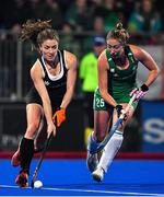 3 November 2019; Natalie Sourisseau of Canada in action against Sarah Hawkshaw of Ireland during the FIH Women's Olympic Qualifier match between Ireland and Canada at Energia Park in Dublin. Photo by Brendan Moran/Sportsfile